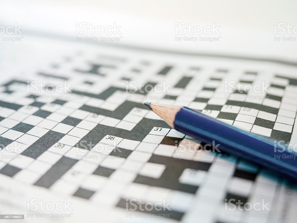 Crossword puzzle game and Pencil stock photo
