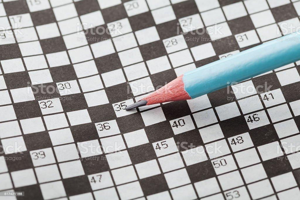 Crossword puzzle or rebus and blue pencil stock photo