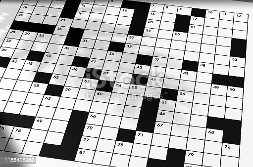Crossword puzzle laying on table with no answers filled in, fictitious