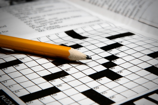 A pencil and a crossword puzzle.