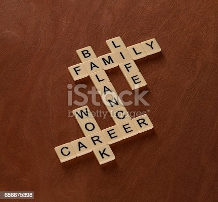 istock Crossword puzzle with words Life, Work and Balance. Life Balance concept. 686675398