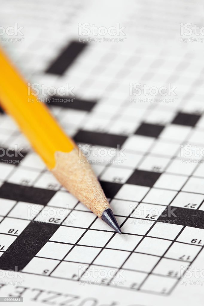 Crossword with pencil-vertical royalty free stockfoto