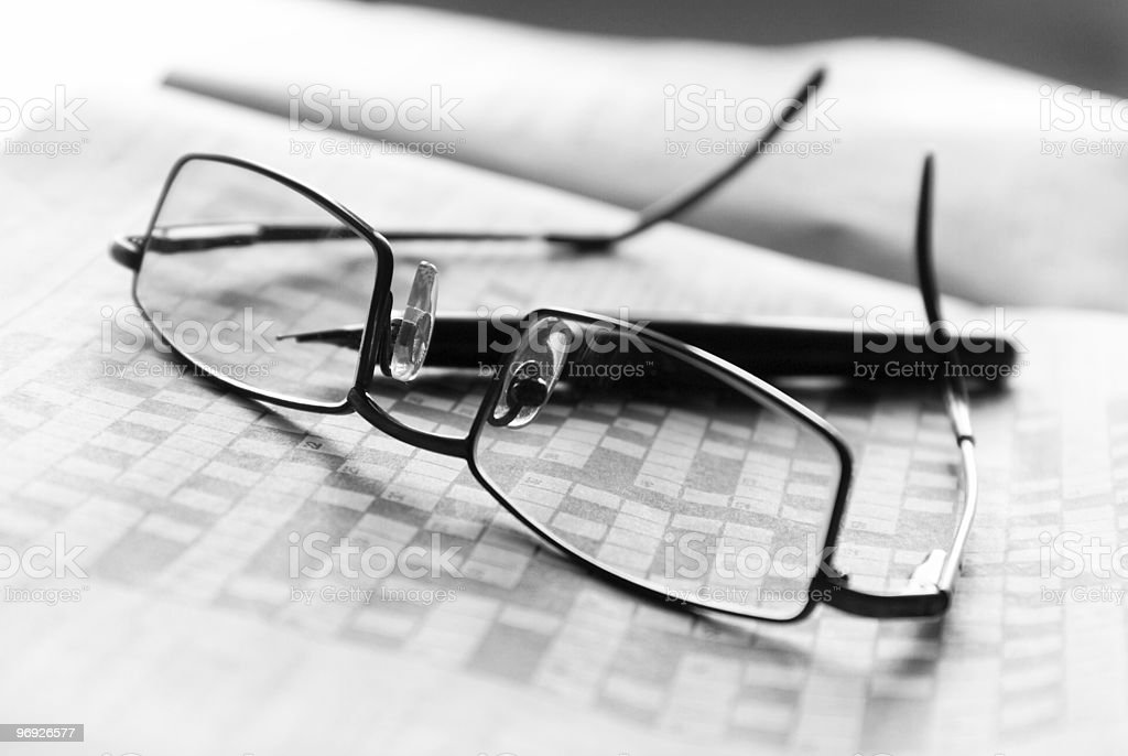 Crosswords and glasses royalty-free stock photo