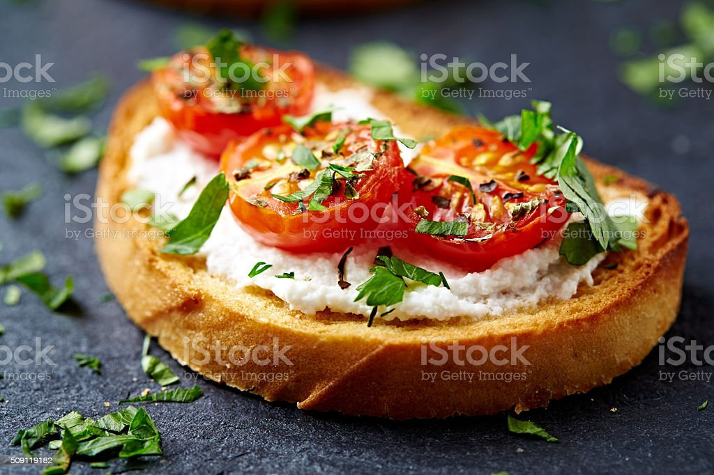 Crostini with cherry tomato and ricotta stock photo
