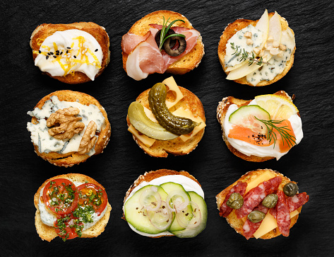 istock Crostini with different toppings on black background 506851942