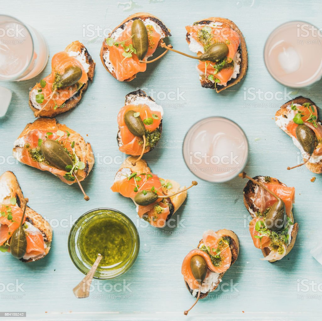 Crostini with smoked salmon and pink grapefruit cocktails royalty-free stock photo