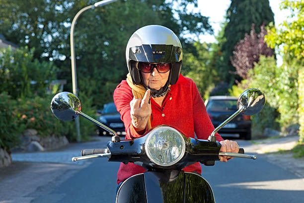 crotchety old lady on a scooter. - crotchety stock pictures, royalty-free photos & images