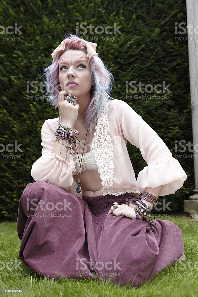 Crouching indie teenager royalty-free stock photo