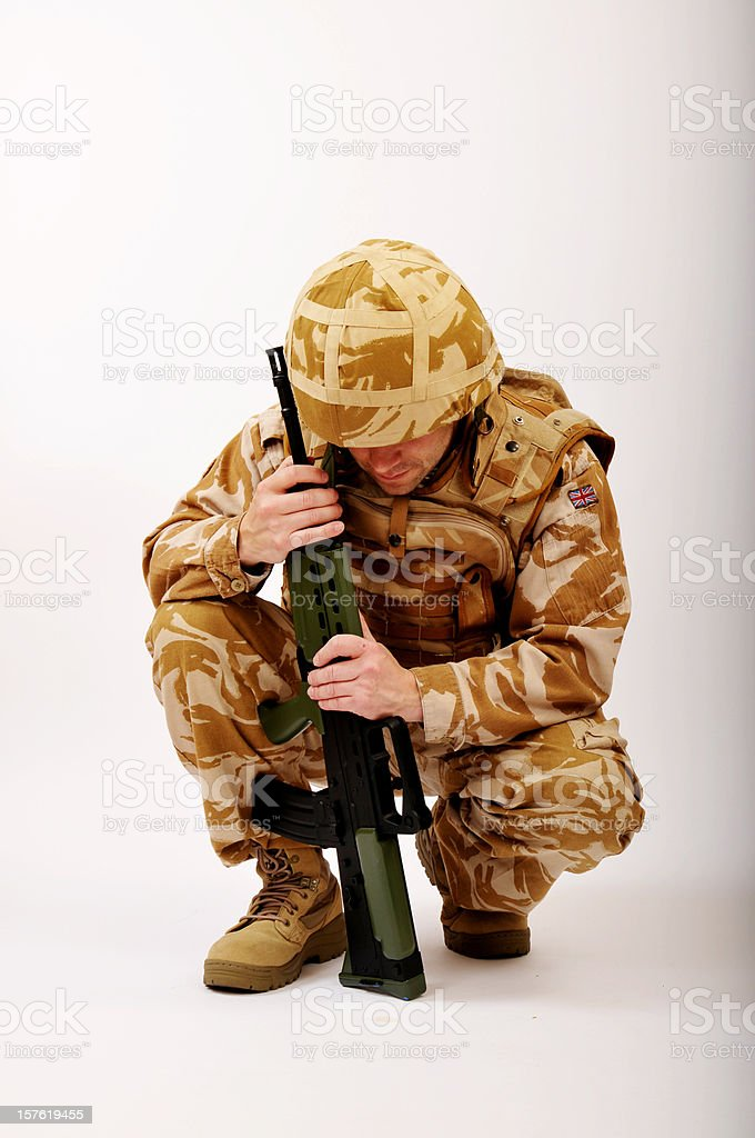 Crouching Soldier In Deep Thought royalty-free stock photo
