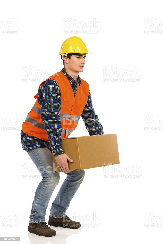 Crouching with a heavy package. stock photo