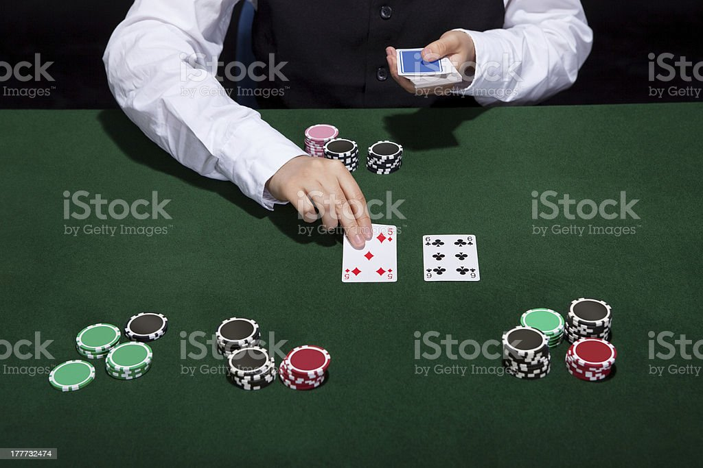 Croupier dealing cards royalty-free stock photo