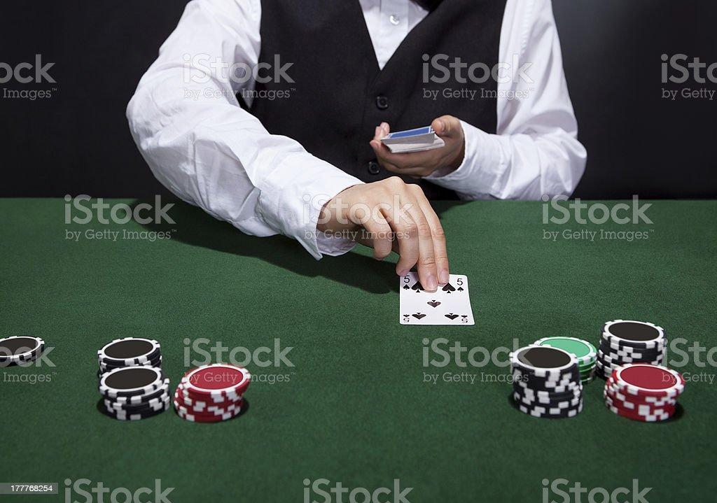 Croupier dealing cards stock photo