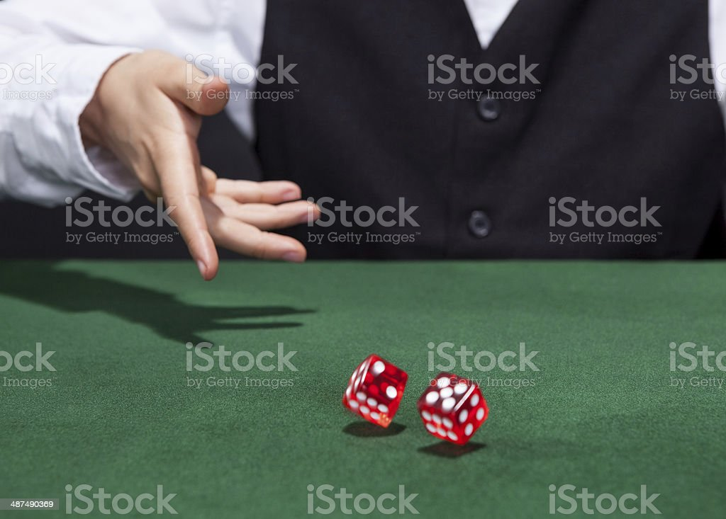 Croupier throwing a pair of dice stock photo