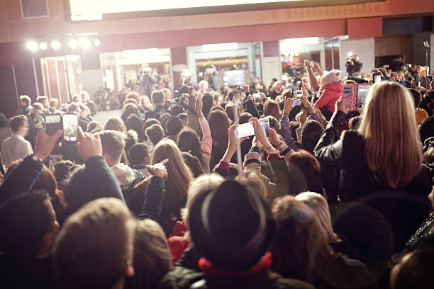Crowd and fans at red carpet film premiere stock photo
