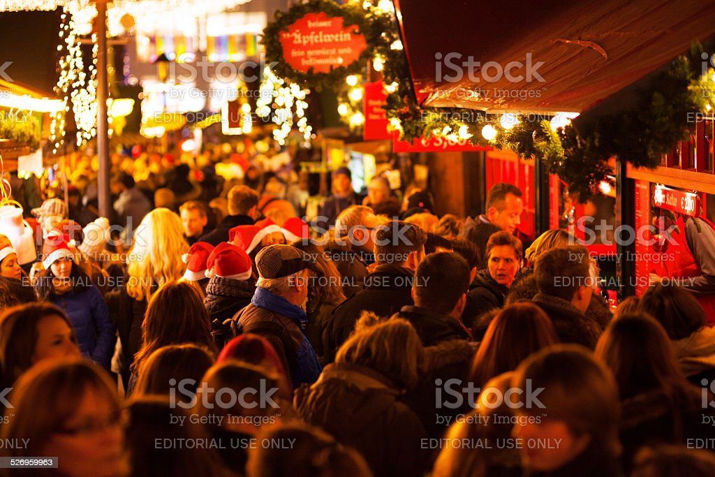 Crowd and market stall for mulled wine stock photo