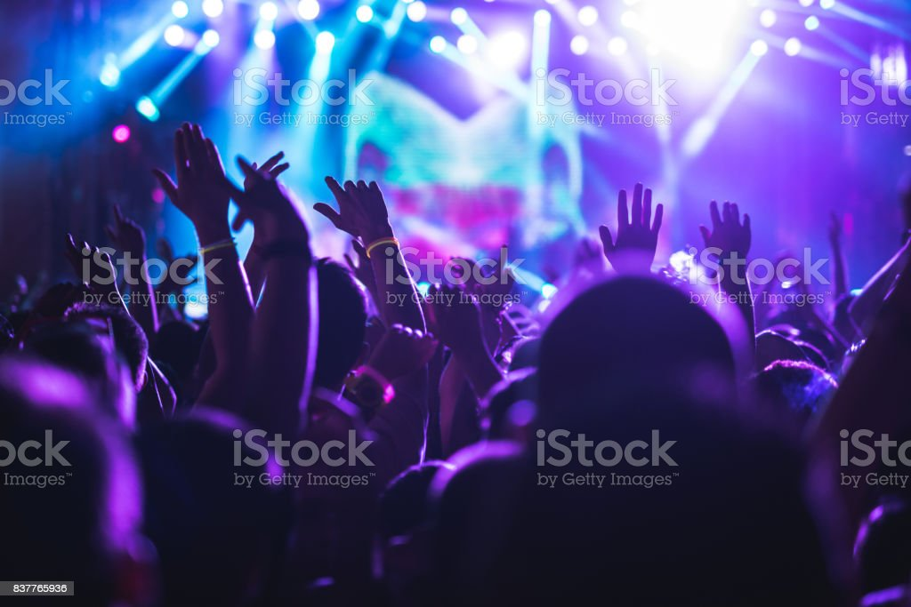Crowd applauding on a concert stock photo