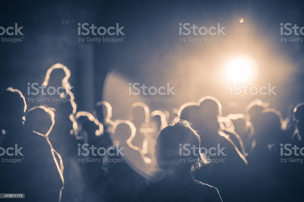 crowd at a concert in a vintage light noise added stock photo