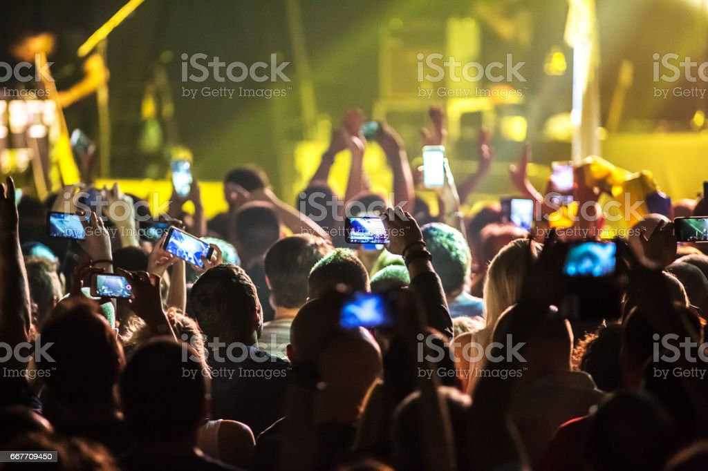 Crowd at concert and blurred stage lights . stock photo