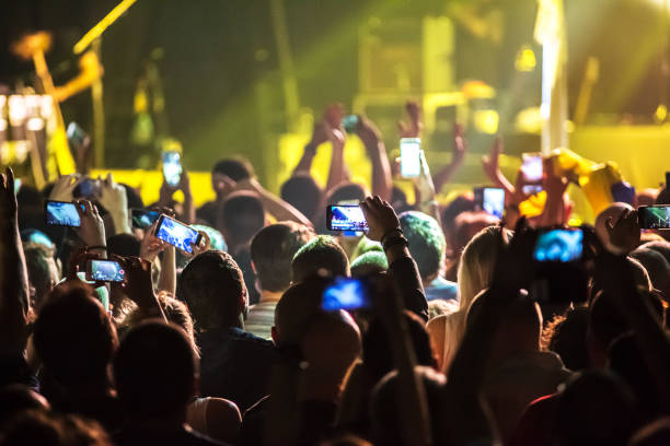 crowd at concert and blurred stage lights . - arts culture and entertainment stock pictures, royalty-free photos & images