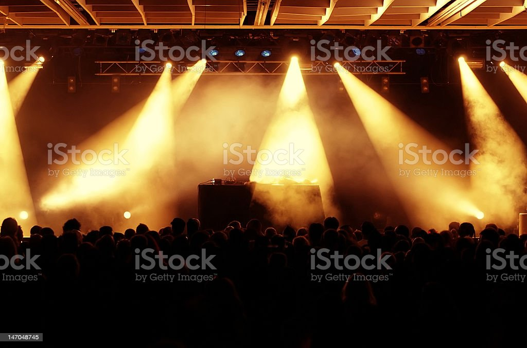 crowd at concert, empty stage stock photo