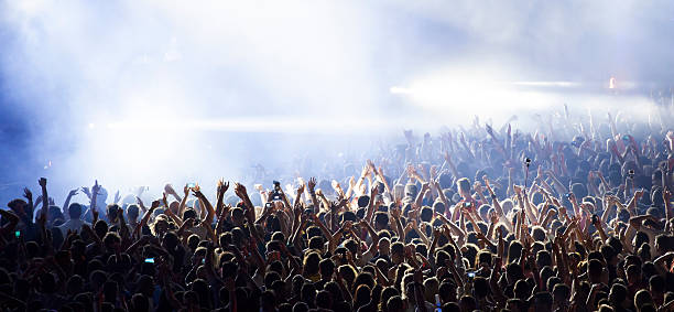 crowd at concert - music style stock pictures, royalty-free photos & images
