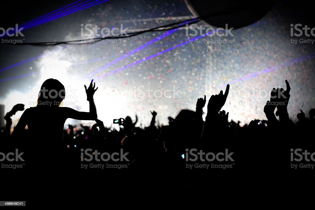 Crowd at Festival with hands up in the air stock photo