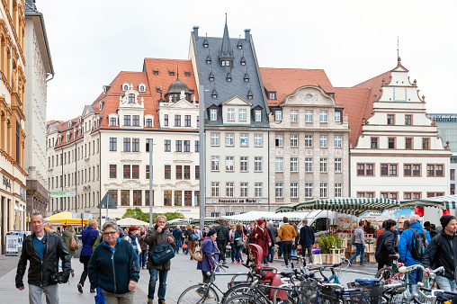 Crowd at Marktplatz, the market square in city centre of Leipzig in Germany, surrounded by historic buildings