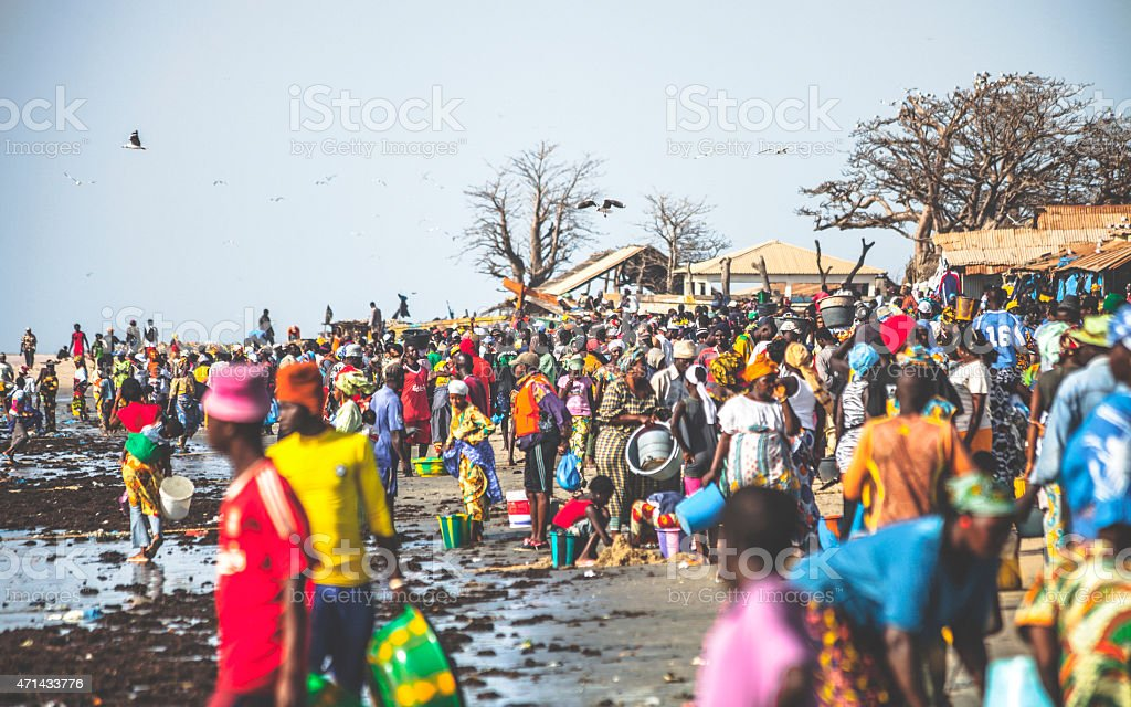 Crowd at Tanji beach fish market. The Gambia. stock photo