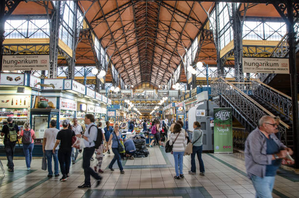 Crowd at the Budapest Market Hall Crowd at the Budapest Market Hall during daytime market hall stock pictures, royalty-free photos & images