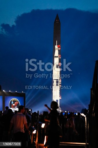 Washington D.C, USA-July 20, 2019: Crowds gather to watch the Washington Monument turn into an outdoor display to commemorate the Apollo Moon Landing's 50th Anniversary put on by the Smithsonian. The National Mall was packed with spectators who watched a real time recreation of the moon landing set exactly to the anniversary's timeline of the event 50 years ago. The National Mall is an outdoor park located in between the Capitol and the Lincoln Memorial.