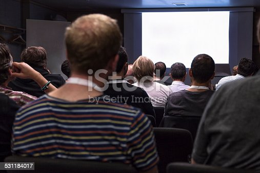 istock Crowd audience looking at blank screen 531184017
