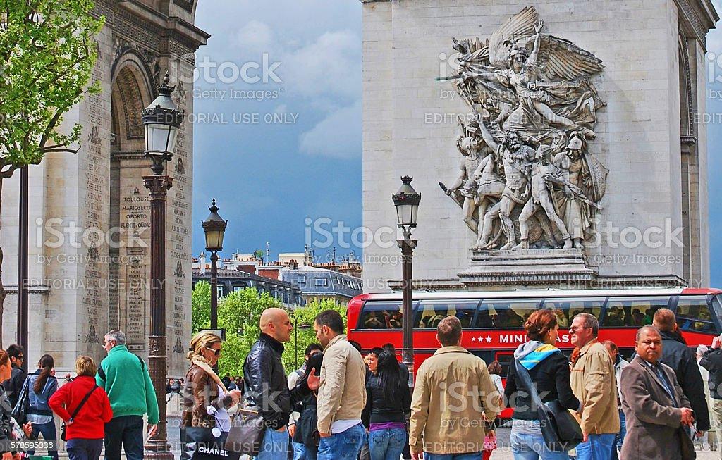 Crowd beside Arc de Triomphe de l'Étoile stock photo