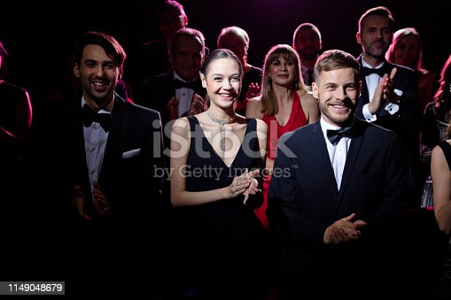 585298714 istock photo Crowd clapping after a beautiful opera performance 1149048679