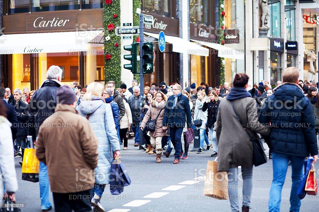 Crowd crossing crosswalk on Kö stock photo