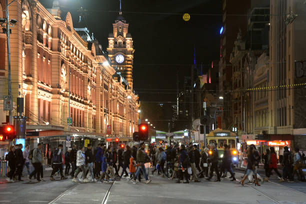 Crowd crossing the street at Flinders Street railway station, Melbourne, Australia stock photo