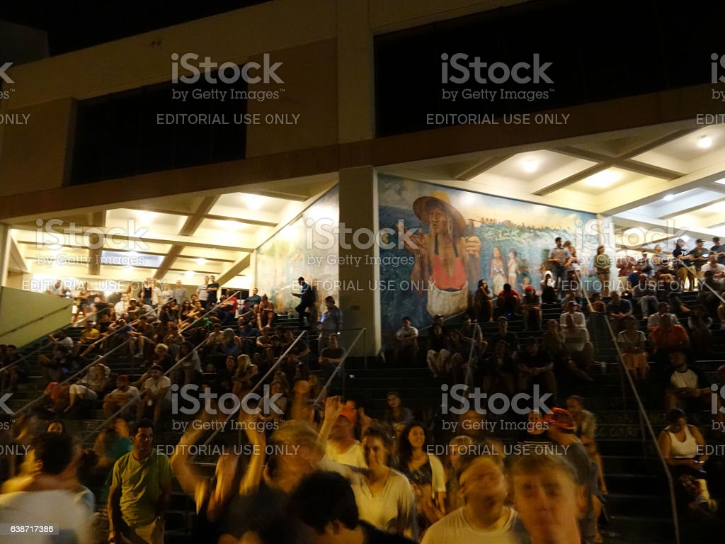 Crowd dances and sits on stairs at Earth Day Concert stock photo
