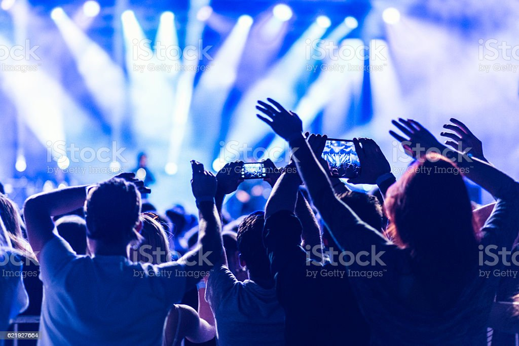 Crowd filming a concert with their smartphones stock photo