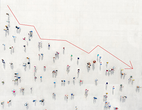 Crowd from above forming a falling chart showing unemployment