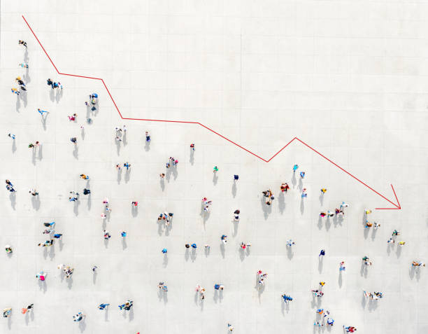 Crowd from above forming a falling chart stock photo