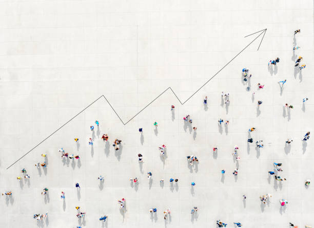 Crowd from above forming a growth graph stock photo