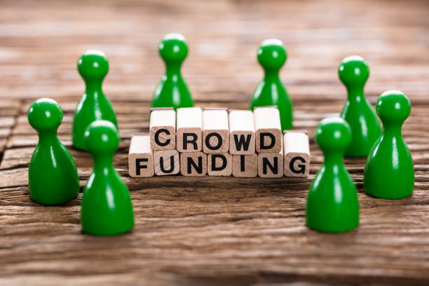 Crowd Funding Word Made With Wooden Blocks stock photo