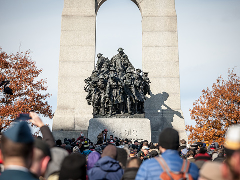 Crowd gathering on National War memorial of Ottawa, Ontario, Canada, on remembrance day to commemorate the canadians who died in conflicts
