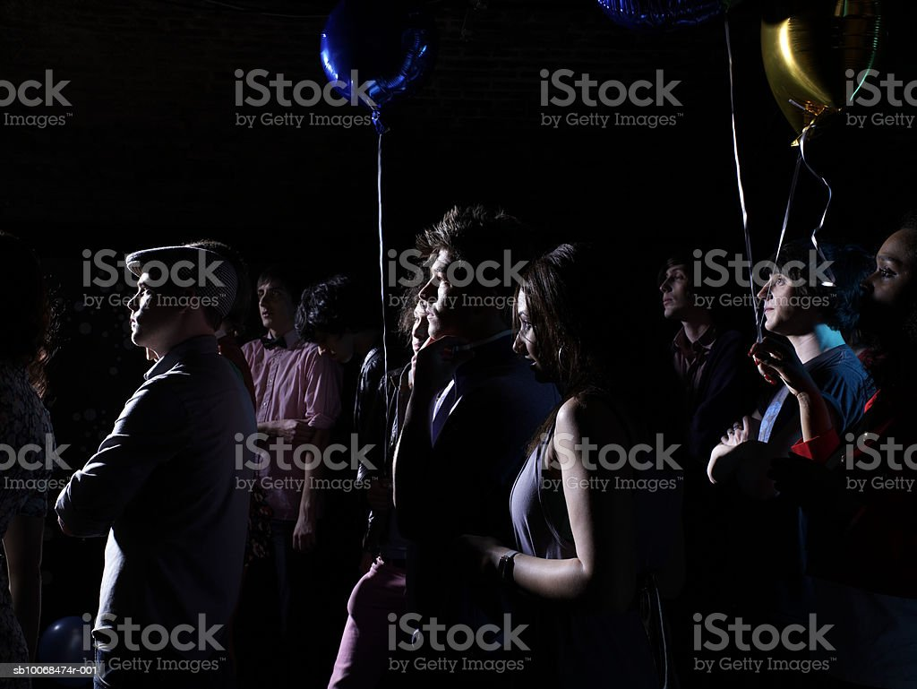 Crowd holding balloons at party royalty-free stock photo