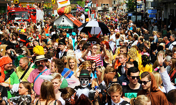 Crowd in carnival parade in the streets of Aalborg, Denmark stock photo