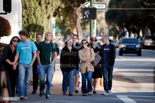 San Luis Obispo, CA USA - April 28, 2011: A crowd of people walking across the street toward the camera on Marsh Street in San Luis Obispo, CA.