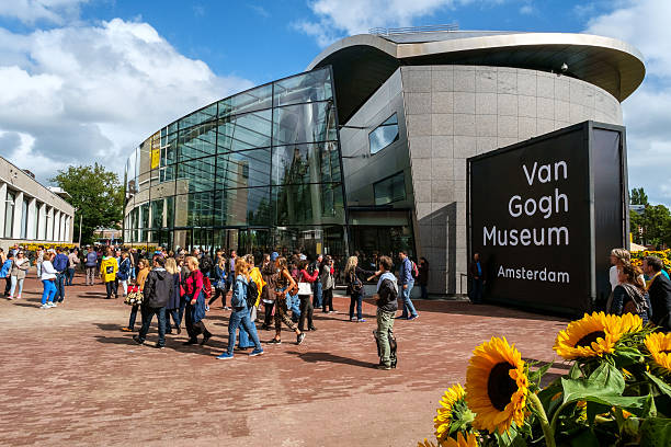 crowd in front of the Van Gogh Museum Amsterdam Amsterdam, the Netherlands, September 5, 2015: people in front of the new wing of the Van Gogh Museum with sunflowers museumplein stock pictures, royalty-free photos & images