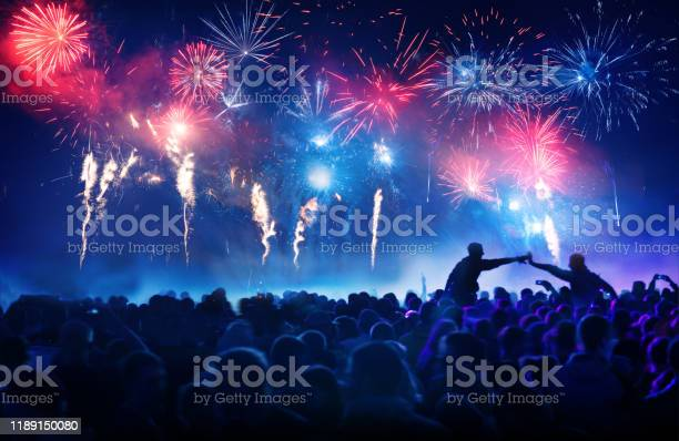 Photo of Crowd in front of vibrant firework display