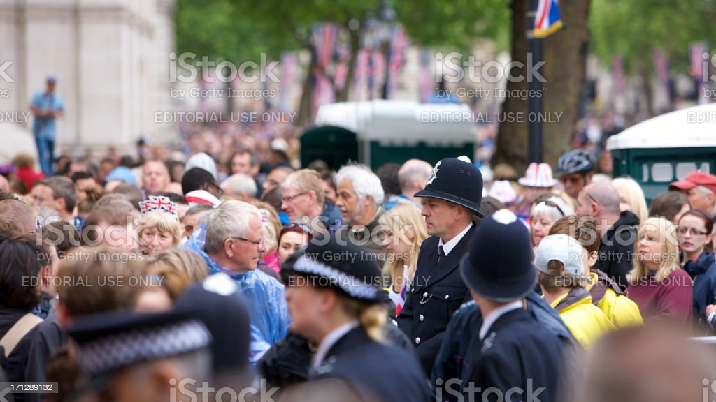 Crowd leaving after the Queens Diamond Jubilee State procession royalty-free stock photo