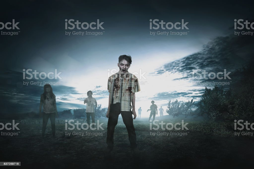 Crowd of aggressive asian zombies walking around stock photo