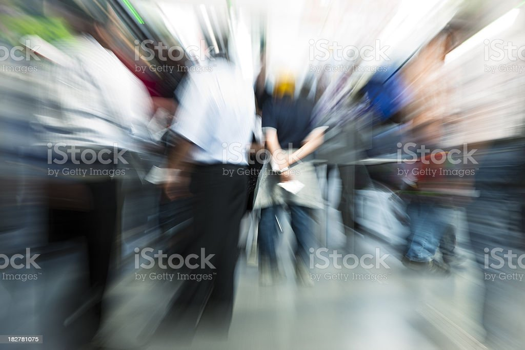 Crowd of Blurred People, Zoom and Motion Blur royalty-free stock photo
